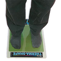 person standing on the Therma-Shape Pad